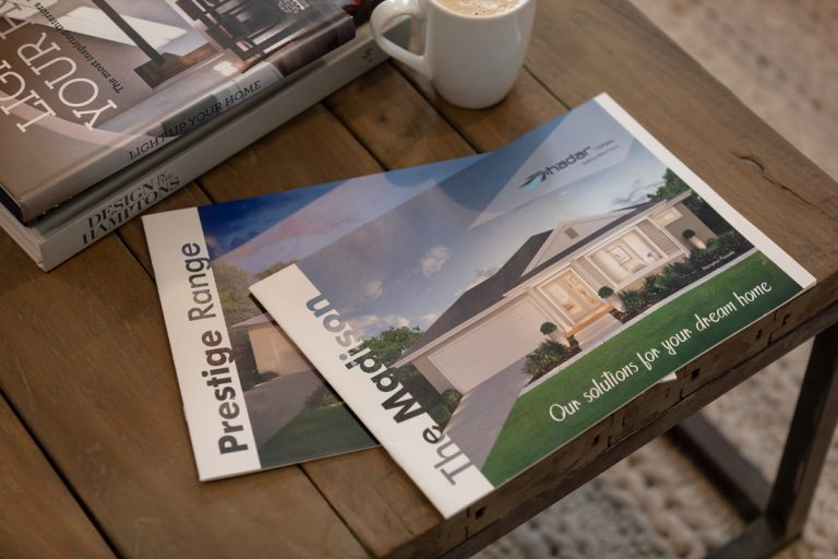 Hadar Homes Brochures on table